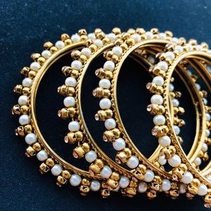 Lot of 4 Indian Style Gold and Pearl Bangles
